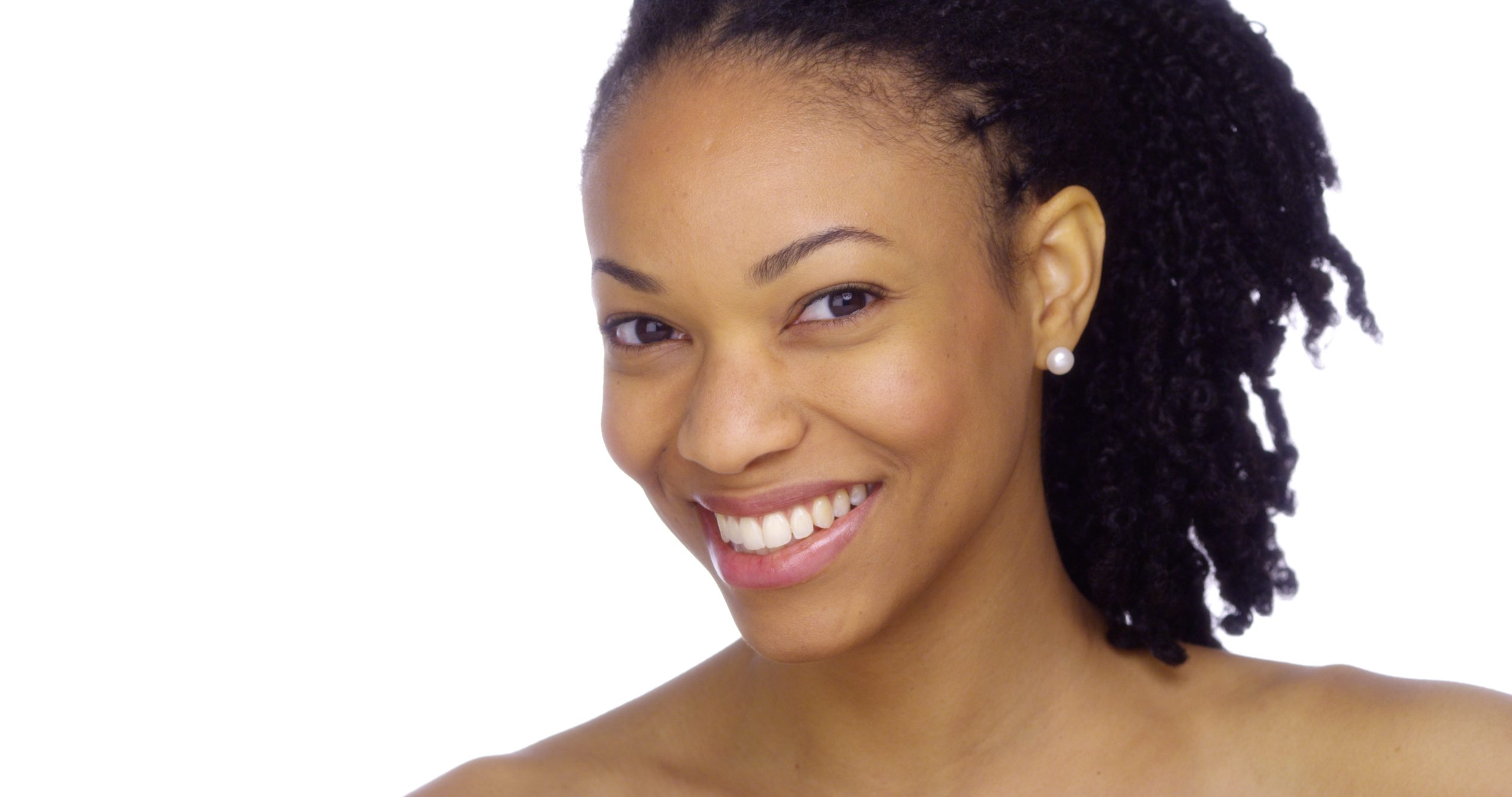 A smiling Black woman with great skin