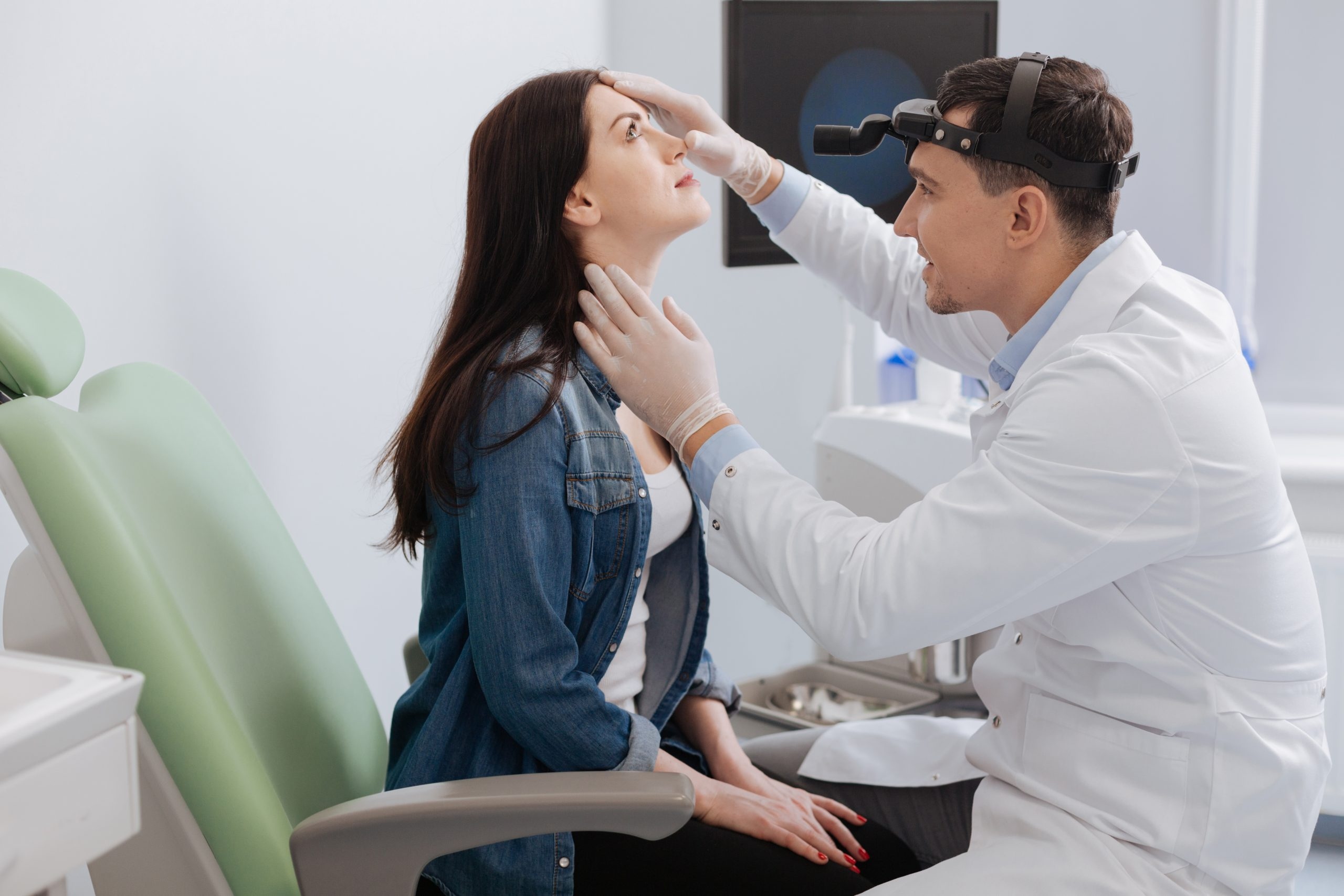 Doctor examining patient's nose